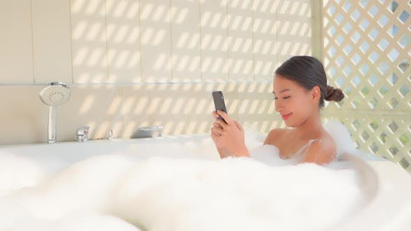 Young asian woman relax in bathtub