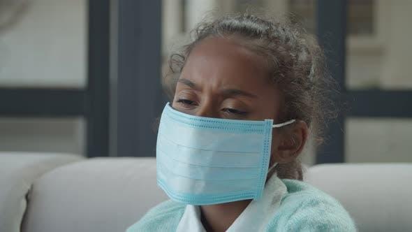 Sad Sick Girl Wearing Medical Mask Indoors