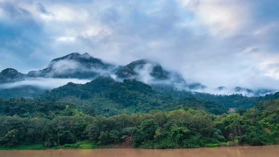 Thumbnail for Time lapse: cloud mist and fog over jungle Nam Ou River Nong Khiaw Muang Ngoi Laos