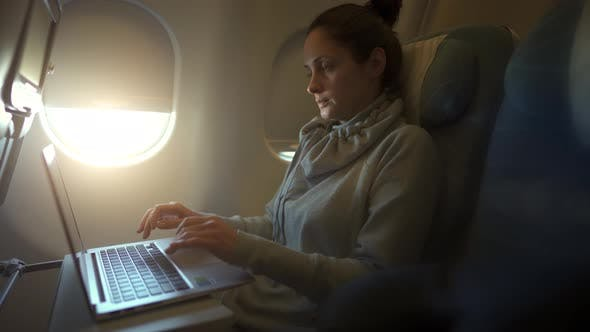 Thumbnail for Girl Using Laptop While Is Sitting in Plane