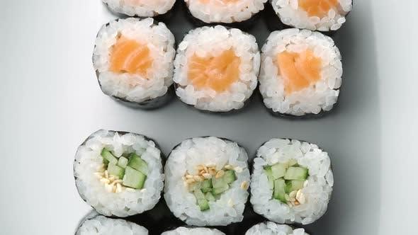 Thumbnail for Fresh Sushi Roll Set Rotating. Typical Japanese Food, Dish Consisting of Rice, Avocado, Salmon, Tuna