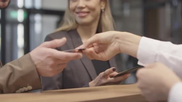 Thumbnail for Unrecognizable Receptionist Giving Room Key Cards to People