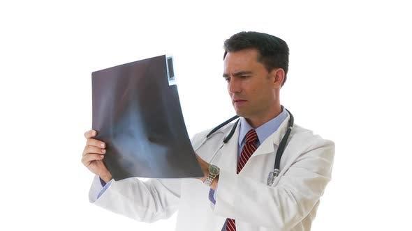 Thumbnail for Doctor examining x-ray