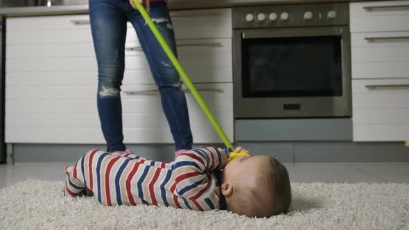 Thumbnail for Female Legs Mopping Floor with Baby