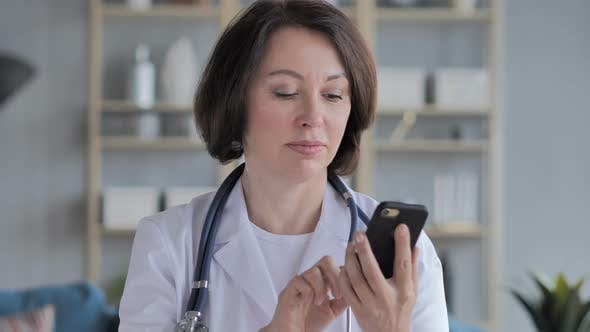 Thumbnail for Old Lady Doctor Browsing Smartphone