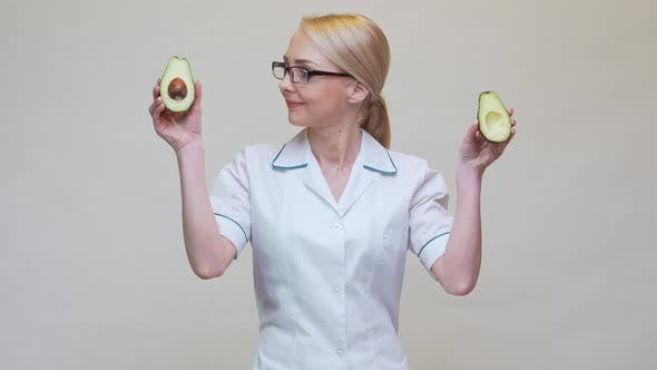 Thumbnail for Nutritionist Doctor Healthy Lifestyle Concept - Holding Organic Avocado