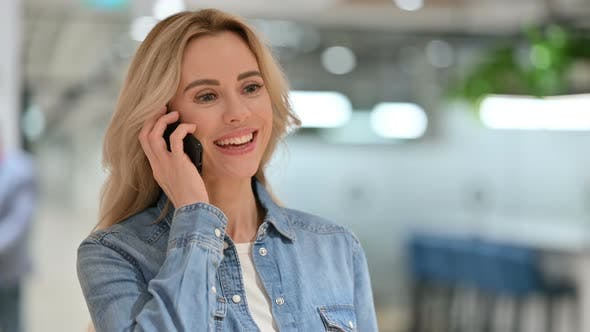 Thumbnail for Young Casual Woman Talking on Smartphone