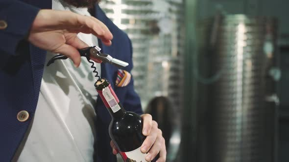 Thumbnail for A Man Is Opening a Bottle of Vine. Corkscrew Opening Bottle of Wine