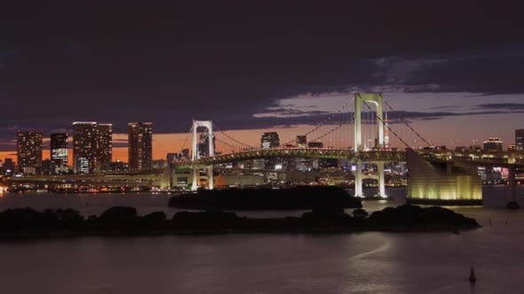 Thumbnail for Time Lapse looking across Tokyo Bay at the Rainbow Bridge and Tokyo