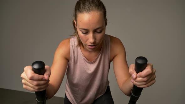 Thumbnail for Dedicated Woman Training on Stationary Bike