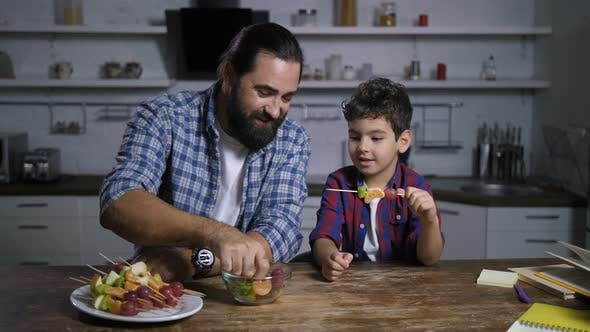 Cover Image for Caring Dad and Son Making Delicious Fruit Kebabs