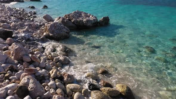 Rocky Shore with Stones and Blue Transparent Sea Water