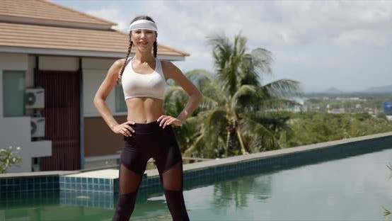 Confident Sportswoman During Training on Poolside