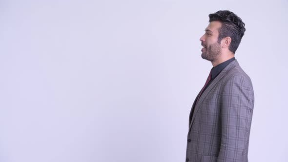 Thumbnail for Profile View of Happy Bearded Persian Businessman Smiling