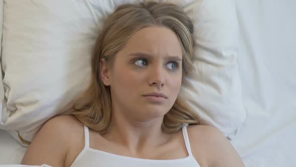 Thumbnail for Pretty Young Woman Is Caught in Bed with Boyfriend, Feeling Shocked, Surprise