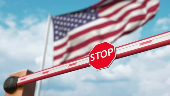 Thumbnail for Opening Boom Barrier with Stop Sign Against the American Flag