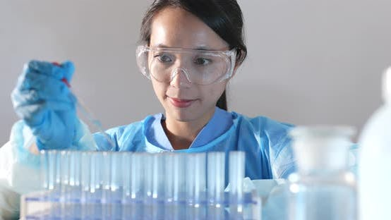 Thumbnail for Scientist experiment in laboratory