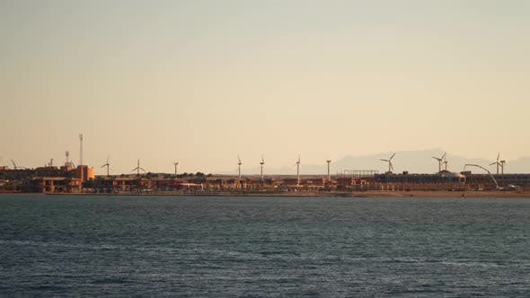 Wind turbines on the coast. View from the sea from the ship