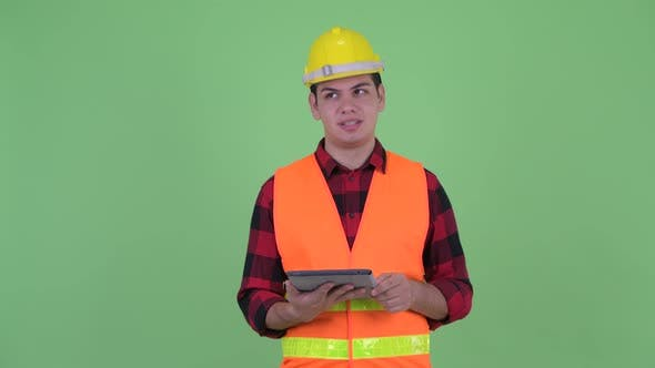 Thumbnail for Happy Young Multi Ethnic Man Construction Worker Talking While Using Digital Tablet