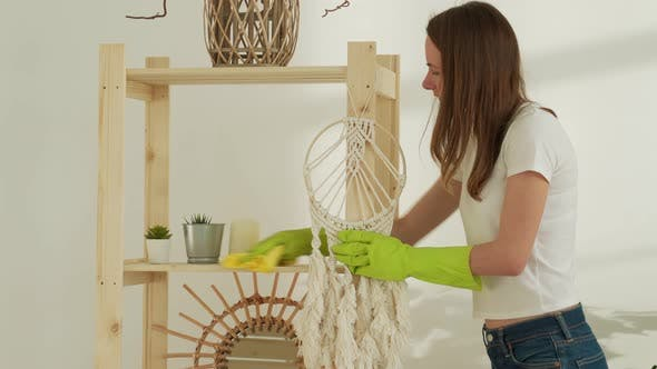 Housekeeping Concept  Happy Woman with Dusting Cloth Cleaning Rack at Home