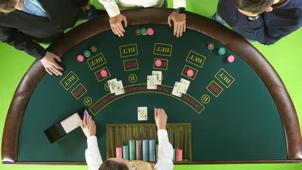 Thumbnail for People Playing Poker at the Table, the Dealer Deals the Cards. Green Screen. Top View