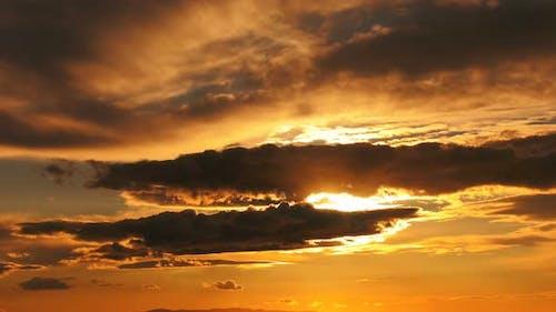Dark Smooth Clouds In Orange Sunset