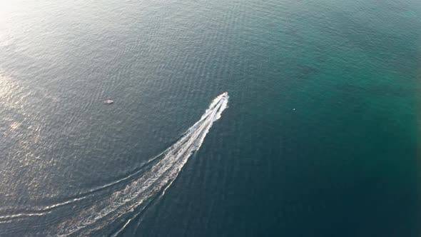 Thumbnail for Aerial Drone Shot Over Small Speed Boat Rushing Adriatic Sea in Croatia