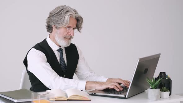 Thumbnail for Hippie Businessman Working at the Office with Laptop
