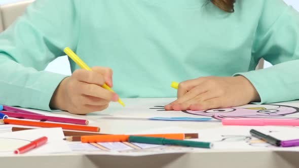 Thumbnail for Child Begins To Draw His Drawing with Different Pencils. Close Up. Time Lapse