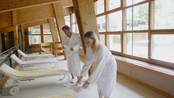 Couple in white bathrobes at spa resort, Alta Badia, Italy