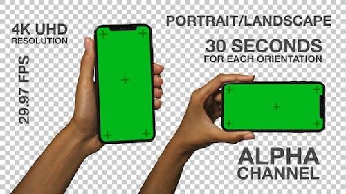 Smartphone in Schwarz Weibliche Hände