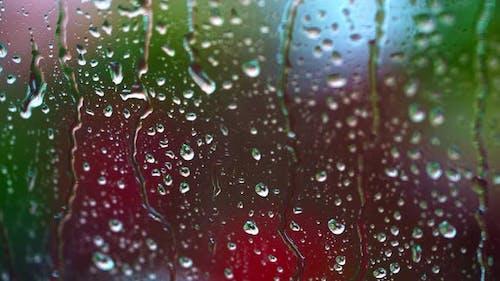 Rainy background on glass