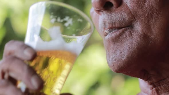Thumbnail for Asian Indian Man Drinking A Beer