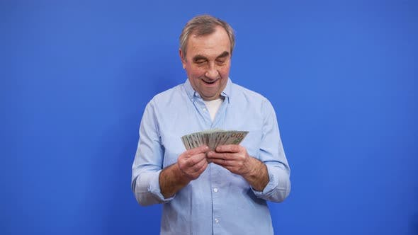 Happy Eldery Man Holding Bundle of Cash Dollars