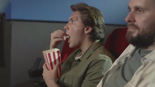 Men Watching Thriller in Cinema