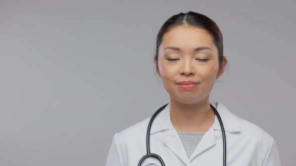 Happy Smiling Asian Female Doctor with Stethoscope
