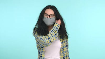 Young Woman Takes Off Face Mask