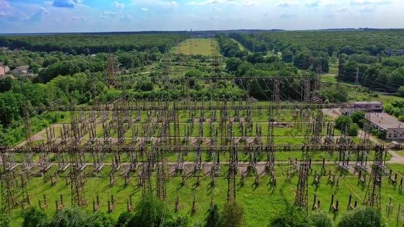 High voltage steel pylons in green field