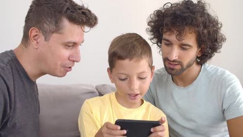Excited Boy Playing Online Game on Smartphone