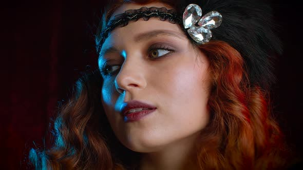 Thumbnail for Portrait of Vintage Styled Red Haired Woman Dressed in Great Gatsby Era Flirting