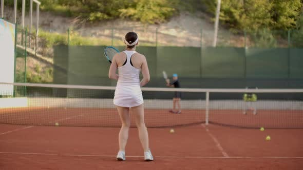 Thumbnail for A Tennis Player Prepares To Serve a Tennis Ball During a Match