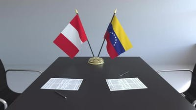 Flags of Peru and Venezuela on the Table