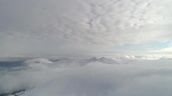 Thumbnail for Aerial view in foggy winter mountain. Environment, nature.