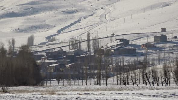 Thumbnail for Village Houses on Edge of Snowy Plain and Hill Slope in Winter Siberia Russia
