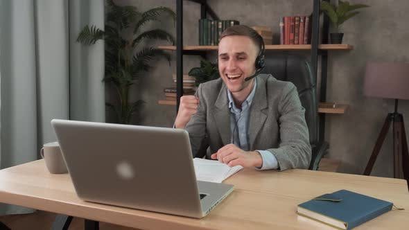 Thumbnail for Happy Businessman Enjoying Good News Celebrating Success in Business Sitting at Desk in Office