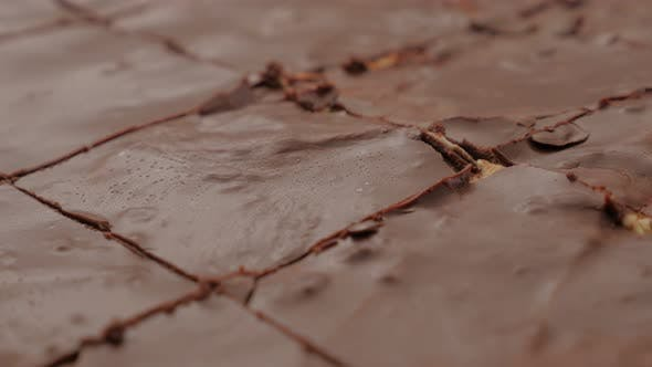 Thumbnail for Choco cake glazed surface close-up cracks after baking 4K 2160p 30fps UltraHD pan video - Chocolate
