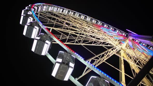 Thumbnail for Giant Wheel Starts Rotating and Gaining Speed, Bright Illumination Sparkling