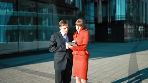 Thumbnail for Woman with Digital Pad Make Offer To Businessman.