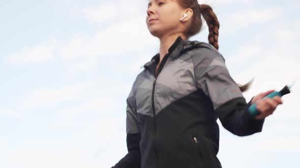 Thumbnail for Young Woman Doing Exercises Using Jump Rope
