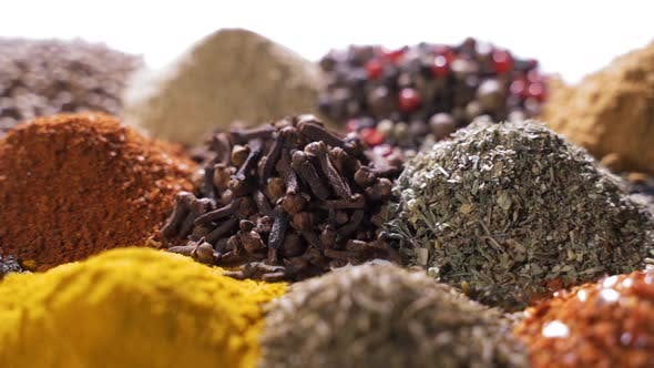 Thumbnail for Different Spices and Aromatic Herbs Laid Out on a White Background